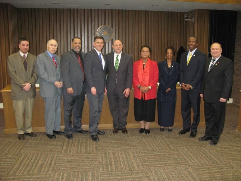 State Sen. Terry Gipson, fourth from left, and Assemblyman Frank Skartados, far right, stand with newly sworn-in Poughkeepsie Common Council members Christopher Petsas, Joseph Rich, Robert Mallory, Lee Klein, Ann Perry, ShaRon McClinton and Randall A. Johnson II.