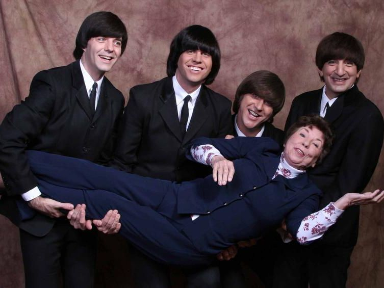 The Liverpool Legends, from left: Bob Beahon (as Paul McCartney), Marty Scott (George Harrison), Kevin Mantegna (John Lennon) and Greg George (Ringo Starr) — with Louise Harrison.
