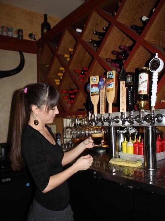 2) Kristina Case pulls beer-1 (credit Nancy Reece Jones).JPG
